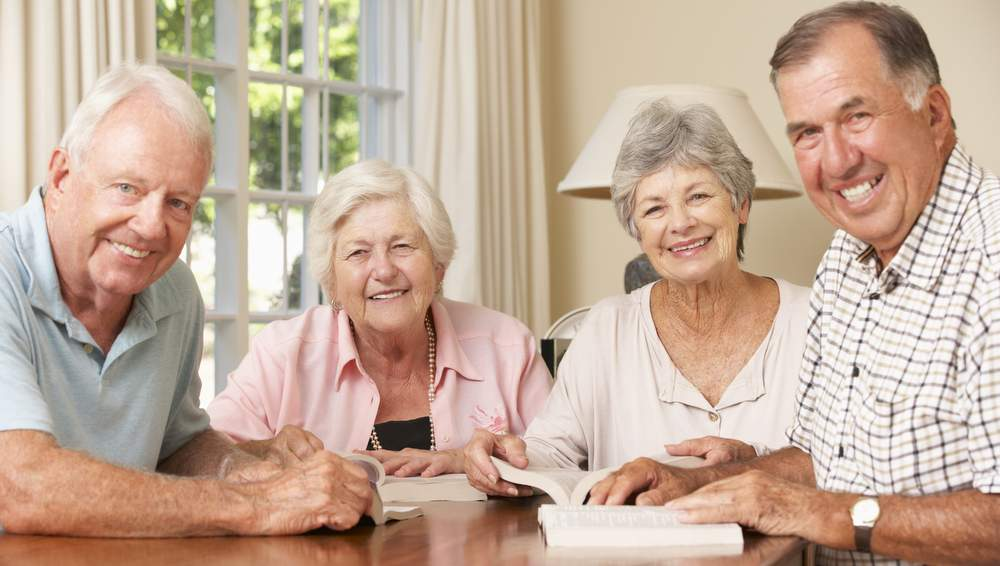 happy seniors maintaining active social lives to help avoid dementia
